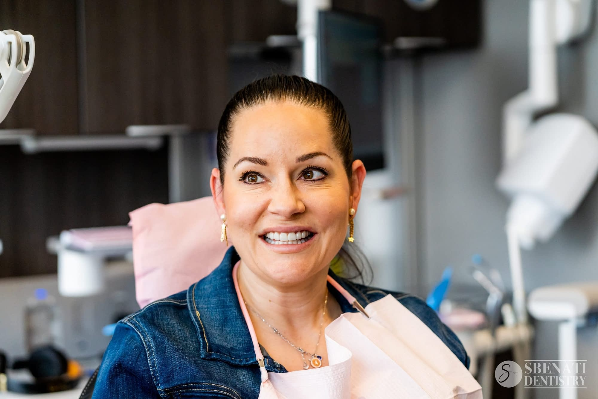 A happy and satisfied patient of london ontario dentist Sbenati Dentistry